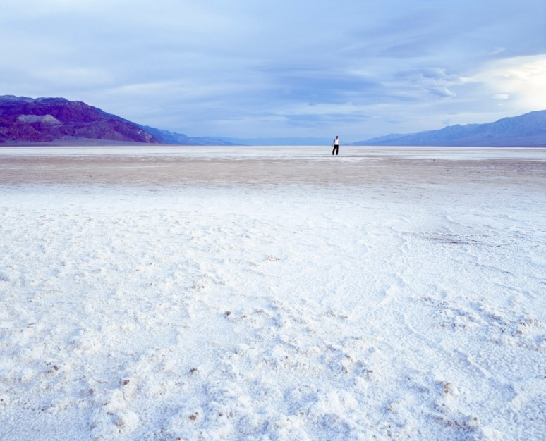 Male in a T-Shirt standing on Rock Salt formations in Death Valley, USA