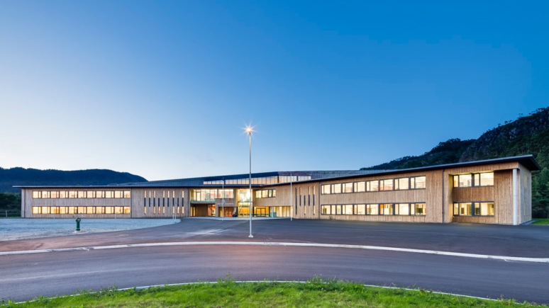 Overview of Nore Neset Skole at night, Os, Norway designed by Ramboll.