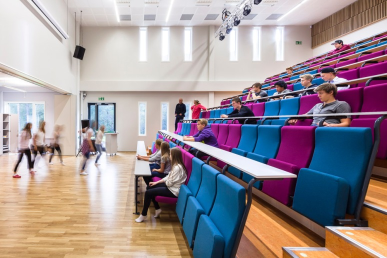The auditorium with students dancing, at Nore Neset Skole, designed by Ramboll.