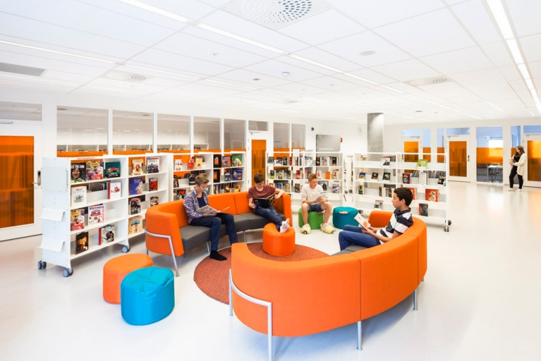 Students using the library facilities at Bjoernsletta School, designed by L2 Arkitekter, Oslo, Norway.