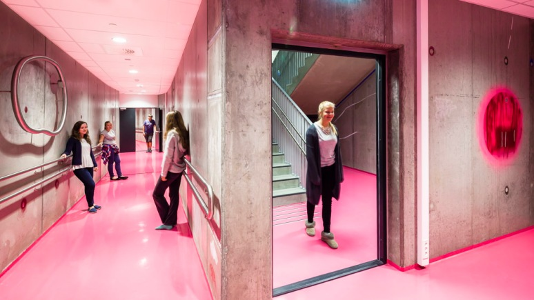 Students relaxing in the corridors of Bjoernsletta School, designed by L2 Arkitekter, Oslo, Norway.