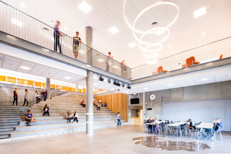 Students using the main atrium at Bjoernsletta School, designed by L2 Arkitekter, Oslo, Norway.