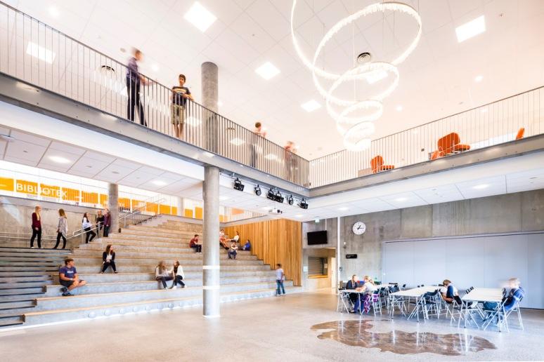 Students using the main atrium at Bjoernsletta School, designed by L2 Arkitekter, Oslo, Norway.
