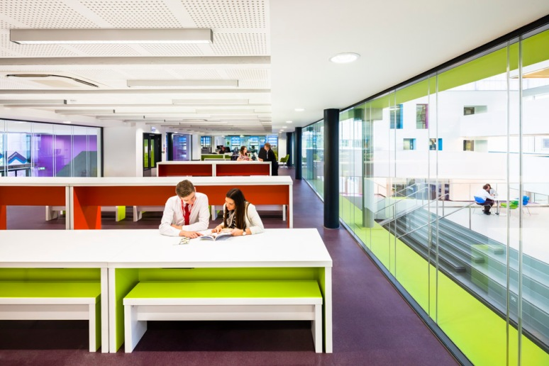 Students in one of the open plan classrooms, North Hertforshire College designed by Scott Brownrigg, Hitchin, UK