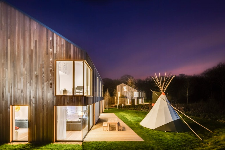 Exterior view of The Woods residential property at dusk designed by Scott Brownrigg, Bedfordshire, UK.