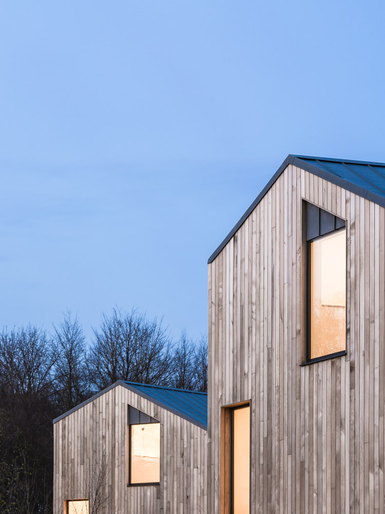 Graphic detail of two facades at The Woods residential property designed by Scott Brownrigg, Bedfordshire, UK.