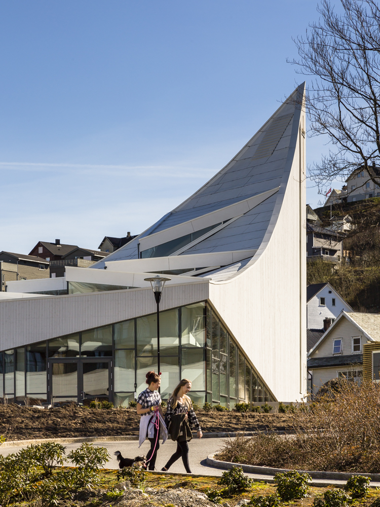 Side profile of Aalgaard Church with two young girls,  designed by Link Arkitektur, Stavanger, Norway.
