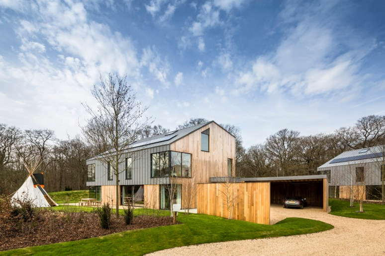 A house and tippee at The Woods residential property designed by Scott Brownrigg, Bedfordshire, UK.