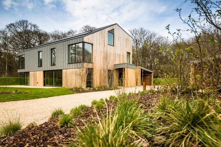 Exterior of a house at The Woods residential property designed by Scott Brownrigg, Bedfordshire, UK.