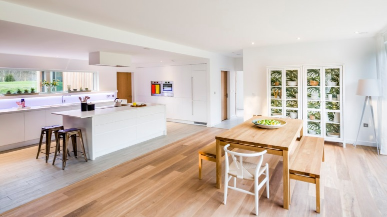 Kitchen and dinning room area at The Woods residential property designed by Scott Brownrigg, Bedfordshire, UK.
