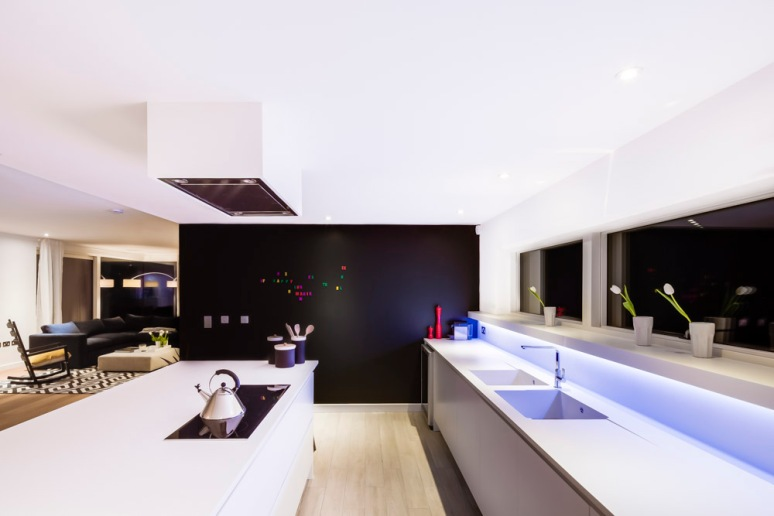 Kitchen area at The Woods residential property designed by Scott Brownrigg, Bedfordshire, UK.