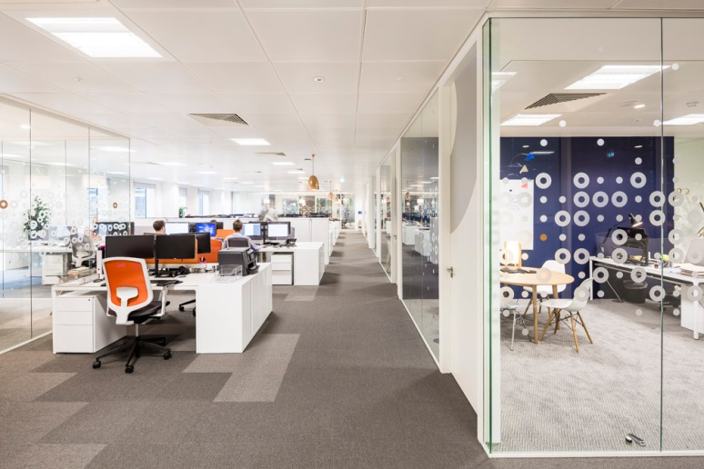 Workspaces at Informa office designed by Ben Adams Architects.