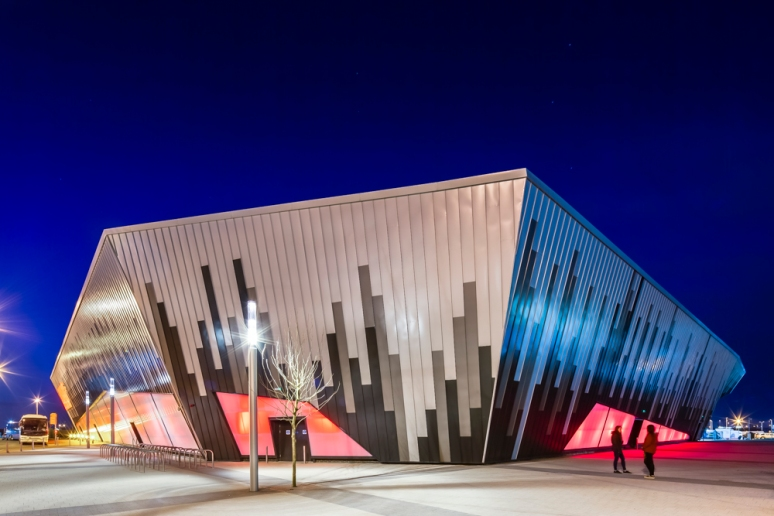 Exterior view of the Ice Arena Wales at night, designed by Scott Brownrigg, Cardiff, Wales, UK.