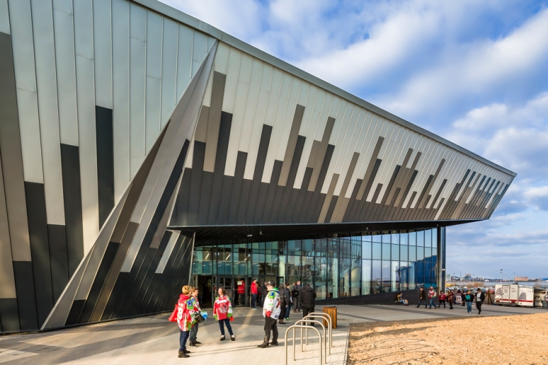 Exterior view of the entrance at the Ice Arena Wales with Red Devil supporters, designed by Scott Brownrigg, Cardiff, Wales, UK.