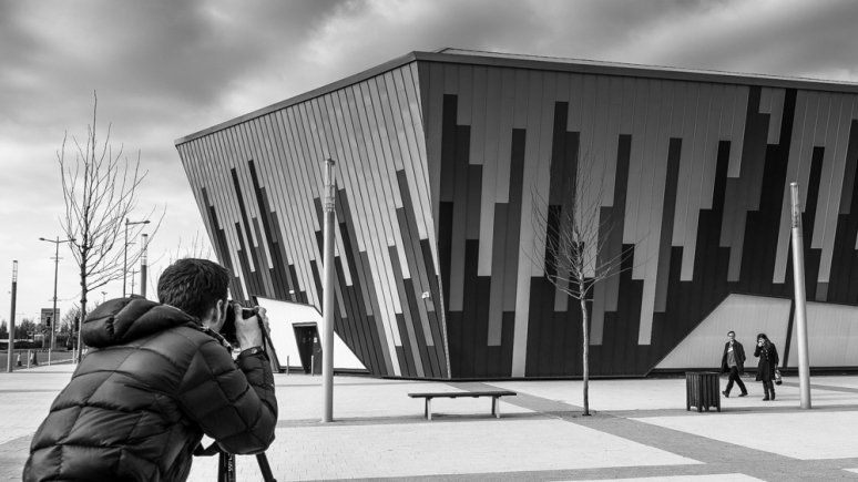 Daniel Hundven-Clements photographing the Ice Arena Wales, designed by Scott Brownrigg, Cardiff, Wales, UK.