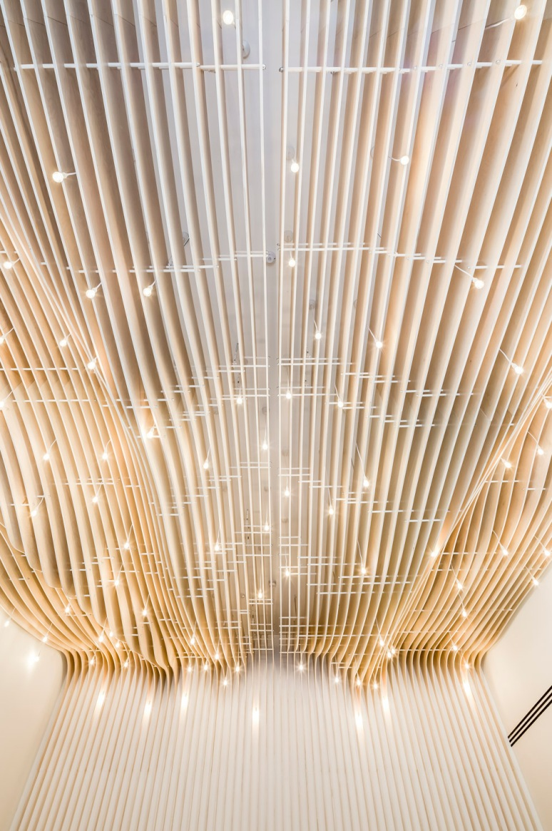 Curved wood structure on the ceiling at 41 Eastcheap Street office, designed by Ben Adams Architects, London, UK.